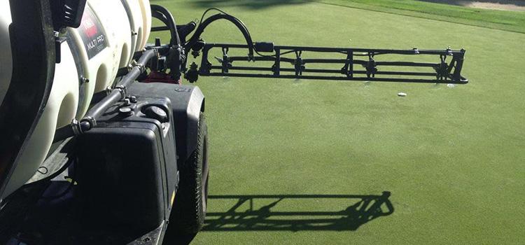 spraying fertilizer on golf course